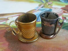 Mini teacups made from thimbles.  Site has other cute ideas also on what to do with thimbles.