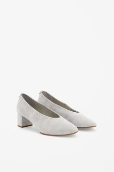 These slip-on shoes, with a covered block heel, are made from extra-soft suede. A round-toe style, they are completed with a leather lining and insole.