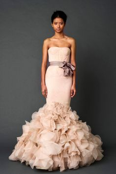 Vera Wang... obviously, because nobody else could make such perfect wedding gowns