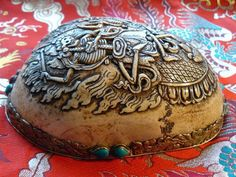 """A kapala (Sanskrit for """"skull"""") or skullcup is a cup made from a human skull used as a ritual implement (bowl) in both Hindu Tantra and Buddhist Tantra (Vajrayana). Especially in Tibet, they were often carved or elaborately mounted with precious metals and jewels."""