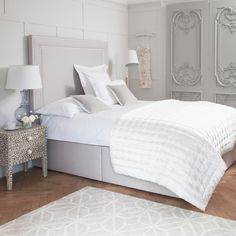 Less is more and this bed speaks volumes. With a high headboard and expertly piped edges this upholstered bed is a must have.