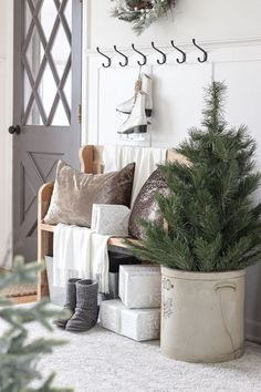 A simple winter white entryway decorated for the holidays in a beautiful farmhou. A simple winter white entryway decorated for the holidays in a beautiful farmhouse christmasentrywa Christmas Entryway, Country Christmas Decorations, Farmhouse Christmas Decor, Cozy Christmas, Rustic Christmas, Farmhouse Decor, Christmas Ideas, White Christmas, Holiday Ideas