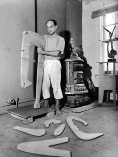 Isamu Noguchi at work in the studio