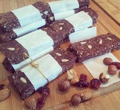 Homemade Energy Bars shared by tiu_vee.  1 cup almonds, 1 cup oats, 5 pitted dates, 1 cup dried fruit (cranberries & apricots), 1/2 cup cacao, 3 scoops chocolate Perfect Fit Protein, 2-3 tbsp boiling water. Place nuts and oats in a food processor. Add the remaining ingredients with water until it starts to stick together. Pour mixture into a baking pan and press until 1-inch thick. Place into the refrigerator for a couple of hours to set. Slice and enjoy!