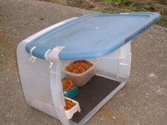 "Outdoor feral cat feeding station.  Uses ""Rubbermaid-type"" tub with industrial plastic zip-ties.  Foam-type shelf liner duct taped to bottom of feeding station.  (*also, edge of blue ""roof"" on feeding station was sealed from rain water dripping in, with Silicone Seal and a cauking gun.)"