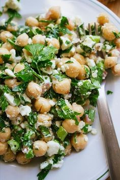 1/2 cup of chic peas 2 cups of arugula 1/4 cup of red onion 1/4 cup of feta cheese 1 diced tomato Dressing: 2 tbsp rice vinegar 1 tbsp extra virgin olive oil *whisk together and add black pepper to taste Total net calories: 335 Very healthy and quite filling!!
