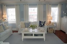 Blue and white livingroom. I could never have white couches, but I still love them!