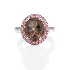 Starting at AU$3,450 in 18ct White #Gold. A fun ring by Natalie Barney #Jewellery Design, this #ring showcases a light coloured #smokey# quartz contrasted by round #pink #sapphires set in #Rose Gold.