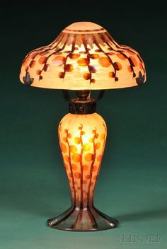 Le Verre Francais Art Deco Table Lamp  Art glass and metal  France  Cameo-decorated with branches with circular buds in orange, dark brown, and mossy green against a mottled peach ground.