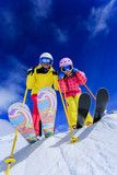 Ski and fun  skiers enjoying ski holiday
