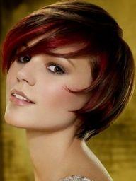 Super-cute short, choppy brunette hair with long, side-swept bangs.