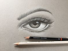 Quick sketch of an eye on grey paper using pencils by Ron Carroll