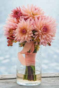 Gorgeous wedding bouquet for the bride made of pastel coral hued dahlia's. More Beautiful Flowers Like This! Dahlia Wedding Bouquets, Dahlia Bouquet, Wedding Flower Arrangements, Bride Bouquets, Wedding Centerpieces, Dahlia Flowers, Flower Bouquets, Modern Wedding Flowers, Blush Wedding Flowers