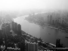 View of river from skyscraper, China - View of the river and the city from a skyscraper on a foggy day - or a smoggy day - China.