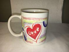 A personal favorite from my Etsy shop https://www.etsy.com/listing/495729114/vintage-i-love-u-mug-blue-purple-red