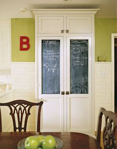 Chalboard paint on a cabinet.  Great idea for mud room/hall.  also, perhaps replace pantry door with double door. Pantry doors.