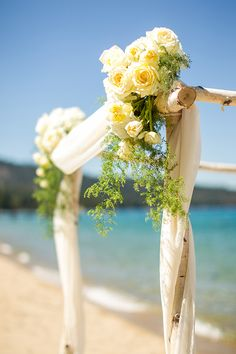 Birch and White Floral Ceremony Arch | MIke Larson Photography | Chic Lake Tahoe Wedding on the Beach