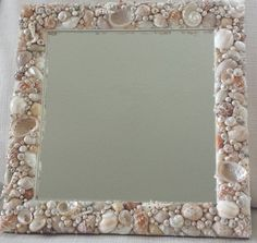 Beach Décor Seashell Mirror. This beautiful Shell Mirror, has been made using a mixture of cream / beige / tan / brown seashells, some of which have a beautiful pearlized finish. It has a magical appearance and would look perfect displayed in any room within your home.  The outside frame of the shell mirror measures approximately 15 1/2 inches by 15 1/2 inches and the inside mirror approximately 11 1/2 inches by 11 1/2 inches.  The shell mirror can also be supplied using a white/cream/beige…