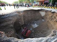 Plummet: A lorry lies at the bottom of a huge sinkhole on Shiliuzhuang road, in Beijing, China in April last year. The driver and his passenger jumped out of the vehicle before it sank into the hole. Severe Weather, Extreme Weather, Resorts Near Disney World, Wild Weather, Florida Resorts, Up House, Weird World, Natural Disasters, Mother Nature