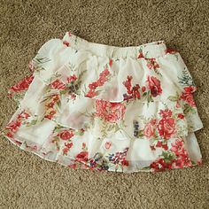 Pretty Skirt nice floral skirt with layered ruffles. i purchased this from forever 21 a while ago and have still never had an occasion to wear it. very pretty skirt with bright red flowers as well as blue and yellow flowers. Forever 21 Skirts