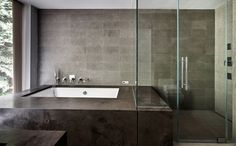 Modern Master Bathroom with Wall mount tub faucet, Slate counters, drop in bathtub, Undermount sink, frameless showerdoor