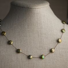 Metallic Green Coin Pearl Station Necklace Knotted on by AUREATA, $50.00