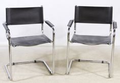 """Lot 693: Mid-Century Modern Italian Chrome and Leather Arm Chairs; Two chairs with chrome supports, leather seats and arm rests and a """"made in Italy"""" sticker on the back rails"""
