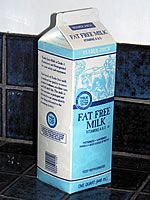 Paper milk cartons are lined with two layers of polyethylene, inside and out. Many people are under the mistaken belief that these cartons are waxed. In fact, although the original paperboard milk cartons were coated with paraffin wax, they haven't contained wax since the 40's when polyethylene became the waterproofing material of choice.