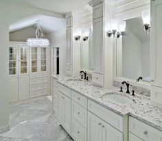 White ice granite in a bright and airy powder room