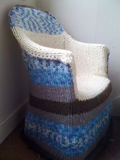 man I wish I could knit ...I would knit slipcovers for all my dining room chairs.  Who's up for the job? :)