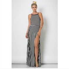 Stripe Slit Dress Look fabulous in this beautiful bold vertical stripe slit maxi dress.  Material-95% Rayon,5% Spandex Dresses Maxi