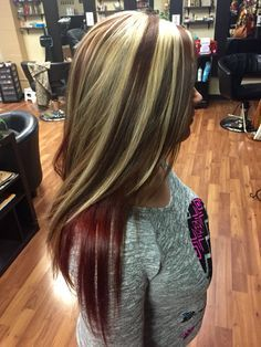 Chunky blonde highlights with red brown base and bright red violet underneath