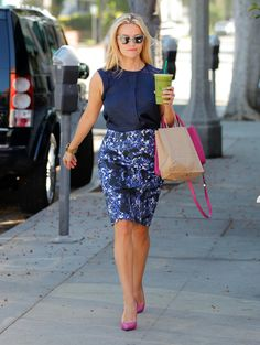 Reese plays up her darker tones with hot pink accessories.