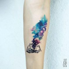 Cosmic book tattoo by Yeliz Ozcan
