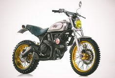 Ducati rolled out a bit of a surprise at the recent Verona Motor Bike Expo in Italy. The company held an exclusive presentation of three Ducati Scrambler specials. Ducati Scrambler Urban Enduro, Triumph Scrambler Custom, Ducati Motorcycles, Custom Motorcycles, Custom Bikes, Scooters, Deus Ex Machina, Bobbers, Motocross