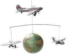 All mini wooden planes are continuously flying around an exact reproduction of a 1930's world globe. The three planes are authentic models of DC-3, Winnie Mae and China Clipper. Use it as a Kid's Mobile or Decor for Home for $74.99