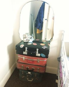 Retro Seaside bedroom ⚓️  up cycled retro dressing table.   Stacked vintage suitcases with a mirror taken from a vintage dressing table balanced on top. Perfect for our retro seaside themed guest room