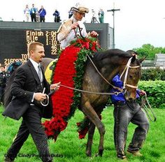 The rose garland for the Kentucky Derby winner first appeared in 1896 when Ben Brush was given a floral arrangement of white and pink roses for winning and in 1904 the red rose became the official flower of the Kentucky Derby