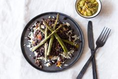 Hearty beans and brown rice make a delicious bed for your favorite veggies here! Asparagus is a good source of fiber and Vitamin A, and roasting the spears brings out all of their natural flavor and stunning color. With a quick, homemade guacamole to top it all off, this Mexican meal will leave you satisfied and refreshed!          From the kitchen of Dr. Michael Greger:    Dr. Greger is all about the evidence. His nonprofit nutrition web...
