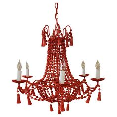 Vintage wood chandelier in coral with beaded swags.    Product: ChandelierConstruction Material: Wood