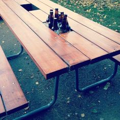 Cooler boxes cut out in the middle of the picnic table- cool idea! Maybe on either side of the umbrella?