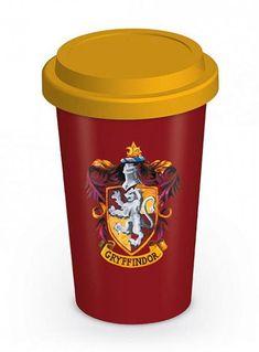 Taza de viaje emblema casa Gryffindor. Harry Potter  Estupenda taza que te servirá tanto de viaje como para tu casa decorada con el emblema de la casa Gryffindor vista en la saga de películas de Harry Potter, fabricada en material de cerámica y 100% oficial y licenciada.