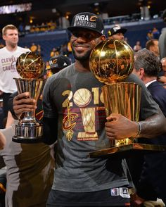 LeBron James of the Cleveland Cavaliers holds his MVP and Championship  Trophy after the game against the Golden State Warriors during the 2016 NBA. 11f1dd7c7
