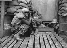 American soldiers take shelter in a sandbagged bunker as North Vietnamese rockets hit the U.S. Marine base at Khe Sanh on Feb. 24, 1968.
