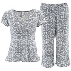 Marilyn Monroe Grey Capri Pajamas This is a Marilyn Monroe brand two-piece pajama set for women. The print is a grey geo flower print. The top is short sleeved with a V-neck. The bottoms are capri length pants with an elastic waistline. The polyester and Spandex blend fabric is machine washable and comfy to wear. These pajamas are great for both sleeping, lounging and gift giving. The first two pictures are depictions of the set. The last is the actual. Marilyn Monroe Intimates & Sleepwear…