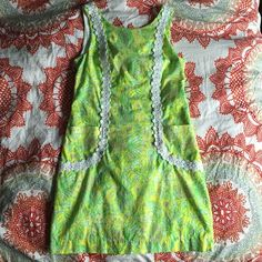 Lily Pulitzer Shift Dress Size 8 in Crazy Cat House. PERFECT condition! Only worn once, last Easter, but have no other occasion to wear it to! Beautiful pattern, pockets on both sides, and a zipper up the back! Willing to negotiate Lilly Pulitzer Dresses