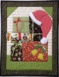 Add this lovely Christmas quilt to your decor!  Santa Hat and Presents Quilt Pattern BS2-374 (advanced beginner, wall hanging)- $10.00  Check out our Christmas quilt patterns. https://www.pinterest.com/quiltwomancom/christmas/  Subscribe to our mailing list for updates on new patterns and sales! http://visitor.constantcontact.com/manage/optin?v=001nInsvTYVCuDEFMt6NnF5AZm5OdNtzij2ua4k-qgFIzX6B22GyGeBWSrTG2Of_W0RDlB-QaVpNqTrhbz9y39jbLrD2dlEPkoHf_P3E6E5nBNVQNAEUs-xVA%3D%3D
