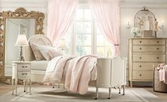If your little one dreams of princesses and palaces then this cream and delicate pink scheme of frills and fancy will suit her down to the ground. French style furniture with a shabby chic finish gives this space an established look, as though this castle has been housing mini royalty for hundreds of years.