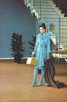Thierry Mugler Ad early 80s Make up: Jasmine for Helena Rubinstein Hair: Klaus for Alexandre de Paris Photo: Denis Piel @ Maison de Radio-France blue wool day dress knit sweater draping draped swag cowl collar long sleeves tights shoes belt designer couture