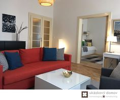 Decorating project for Airbnb apartment in Prague, Czech Republic #livingroom #orange #sofa #mirror #airbnb #prague #praha #czechrepublic #czech